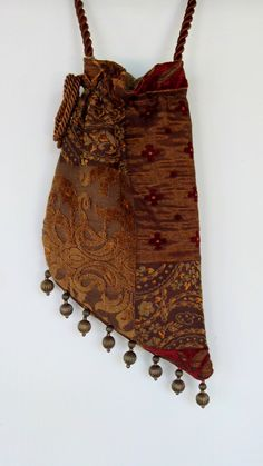 Gypsy Tapestry Bag Beads Woven Patchwork Bohemian Bag Boho Bag Tapestry Bag Gypsy Angle Bag Hippie Bags. $40.00, via Etsy.