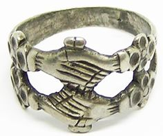 This is a fabulous medieval silver wedding ring, dating to the 15th - early 16th century A.D. The ring is beautifully designed as two rings joined as one, with the clasped (fede) hands each holding a heart. The shoulders are decorated with stylized 'gillyflowers' again symbolic of blossoming love and betrothal. Medieval lovers gave each other rings, and rings were used to mark betrothals and weddings, but among surviving rings it is impossible today to distinguish these different uses.