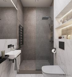 In the apartment there are two bathrooms, one of which is only 2.4 m2, but at the same time it contains a shower, a toilet and a small wash-basin. We used a contrasting combination of white and brown marble, black mixers and added a blue color that is present in every room – the family's favorite color.