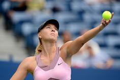 Maria Sharapova (RUS)[3] in action against Marion Bartoli (FRA)[11] at the US Open. - Rob Loud/USTA