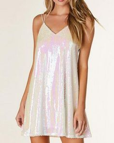 7f985f878e0 Sleeveless V-neck cami dress with iridescent sequin exterior. Full lining  with multi strap design that criss crosses in back.