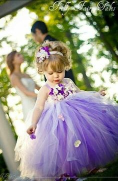 Purple Flower Girl!  Come to Davison Bridal in Davison, MI for all of your wedding day and special event needs!  Call (810) 658-6070 or visit our website www.davisonbridal.com for more information!