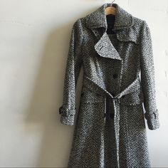 | HP Banana Republic Wool Coat Beautiful, high quality, extra warm, button down, wool tweed peacoat (cream and black) with belt.  75% wool and 25% nylon.  In excellent condition. Banana Republic Jackets & Coats Pea Coats