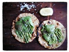 Toasted corn tortillas toasted with mashed avocado, lime and sea salt