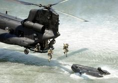 US Special Forces jumping from a hovering Chinook onto a boat