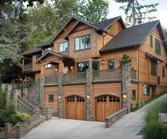 Three Level Plan with Warmth and Elegance - 69144AM   2nd Floor Master Suite, Butler Walk-in Pantry, CAD Available, Craftsman, In-Law Suite, Luxury, Mountain, Northwest, PDF, Photo Gallery, Premium Collection, Sloping Lot   Architectural Designs