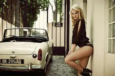 Looks like she drives a classic Midget in her lingerie. I bet she doesn't get any tickets.