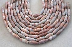 Red Vein Jasper Barrel Gemstone Beads, Jewelry Supplies, Bead Supplies, Jewelry Making Beads, Jasper Beads, Craft Supplies, Full Strand   Versatile red vein jasper barrel beads will make a statement in all your jewelry designs. They are long barrel beads with a smooth, good polish and interesting colors and patterns of red, white and gray. Pair them with turquoise, red agate and silver for a southwest style chunky necklace. Each strand is 16 long with 14 beads per strand. They measure 12 x…