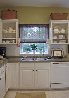 Take off cabinet doors of frequently used dishes so you're not always opening and closing.  If they are frequently used they won't be getting dirty from being in the open.