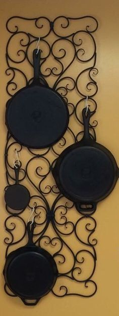 I love this idea for storing cast iron skillets and cookware. The black iron trellis wall hanger will match any kitchen. Keep your tools at the ready with this organization method.