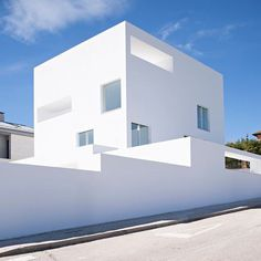 this stark white home with square and rectangular openings is by estudio campo baeza. the spanish residence was one of #designboom's popular #architecture articles this week! by designboom