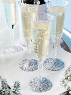 Dollar Store Champagne Glasses | Cupcakes in dollar store champagne flutes. This is so creative!