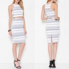 XX The TENILLE striped skirt set - GREY A two piece set featuring textured striped detailing all throughout. Crop top with round neckline. Sleeveless. Zipper back closure. Skirt features zipper back closure & finished hem. NO TRADE, PRICE FIRM Skirts Skirt Sets