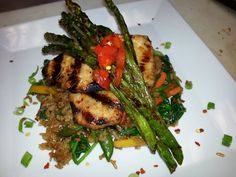 You must try Sean's flame grilled chicken thigh nestled in a bed of dirty rice with garden fresh asparagus and hand cut scallions.Garnished with red peppers.