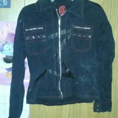 Black Jacket Still in good condition. No fading just a little linty from being washed. No flaws with the jacket. The size is L but can fit a medium just fine. Their is a light star in it as seen in the picture. Jackets & Coats Jean Jackets
