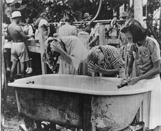 Santo Tomas Internment Camp Bathtub for hair washing. Washing clothes in the back. Margaret Evalyn Whitaker on right in the blouse with flowers on the blouse's pockets Margaret's mother, Evalyn Eddy Whitaker, in the middle Bataan Death March, Devon Rex Cats, Nurses Station, Hair Magazine, Prisoners Of War, Handmade Hair Accessories, Bull Terrier Dog, Washing Clothes, Hair Washing