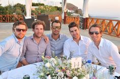 wedding reception at Imerovigli Palace in Santorini, relaxed groom party