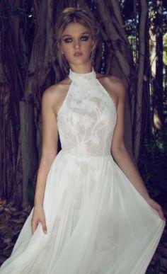 Elegant high neck halter wedding dress with subtle floral embroidered detail; Featured Dress: Limor Rosen