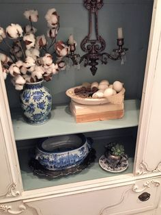 Blue and white, cotton stems, sconces, old books, painted furniture, Annie Sloan, Old White over Old Ochre