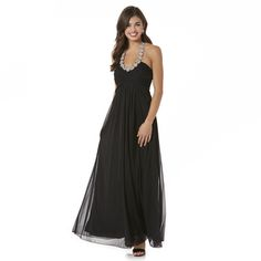 When the occasion is formal, you can make a sweeping entrance wearing this junior's <strong>chiffon maxi dress from Bongo</strong>. Rhinestone-encrusted halter straps pair with a pleated, padded bodice to offer shapely support and mesmerizing sparkle. This long formal gown is styled with an empire waist over a sheer skirt that floats over the knit lining. The floor-grazing hemline offers graceful movement, ensuring you a flattering look in this fancy frock.