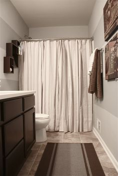 Great idea...two shower curtains and a regular rug. I want these stripes, the cabinets and this color!