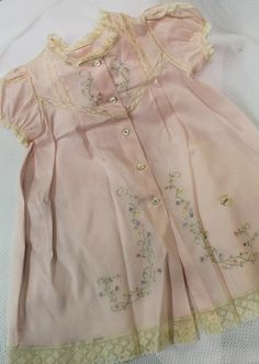 "Ms. Dot made this beautiful ""In The Garden"" sweet pink Nelo daygown with ecru French lace. The pattern is Sweet & Simple Daygown Collection by Old Fashioned Baby and Ms. Dot designed the embroidery designs for the dress."