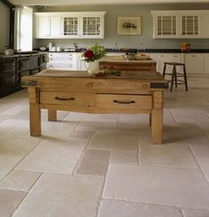 kitchen floor Beautiful in combination with white kitchen / wooden top  wooden floor in dining area
