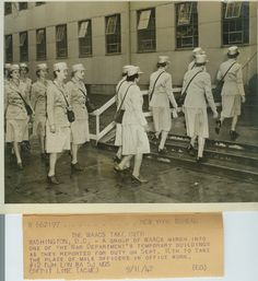 'The WAACs take over'  A group of WAACs march into one of the War Department's temporary buildings as they reported for duty on Sept. 18th to take the place of male officers in office work. Washington, D.C. 9/18/42 ~