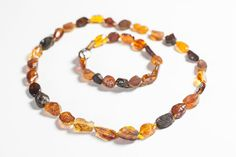 Luxury Baltic amber necklace and bracelet. Beaded natural raw unpolished amber jewelry.