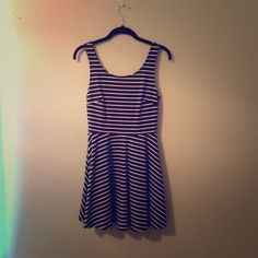 Striped Low Back Bow Dress Black and white striped dress. Tight fitted until it flows out at waistline. V-back with bow. Worn a couple times. Good condition! Size small. Dresses