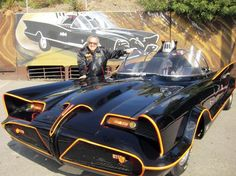 In this October, 2012 photo, famed auto customizer George Barris poses with the original Batmobile in Los Angeles. Batman's original ride, from the 1960s TV series, will be auctioned on Jan. 19, 2013, at the Barrett-Jackson auction house in Scottsdale, Ariz. The 19-foot-long black, bubble-topped car was used in the TV show that starred Adam West as the Caped Crusader. Barris transformed a one-of-a-kind 1955 Lincoln Futura concept car into a sleek crime-fighting machine.