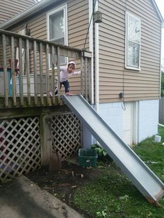 Why walk down steps when you have a reclaimed metal slide off your deck! Reclaimed metal slide deck with slide Portland House, Metal Slide, House Yard, Back Deck, Upper Deck, Lawn And Garden, Wood Pallets, Fixer Upper, Decks