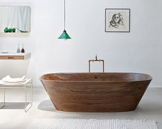 Shell is a minimalist design created by Austria-based designer Nina Mair. The Shell bathtub is made of genuine, hand-polished and oiled walnut. It is carved from a solid block of aromatic walnut using a precision CNC milling machine. (2)