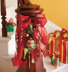 Deck the Halls - Create an eye-catching focal point for any room, entryway or wall with a bold cluster of ornaments tied with a gorgeous ribbon.