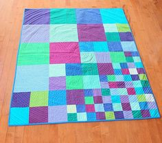 Modern Patchwork Quilt - Scattering Squares. $190.00, via Etsy. I like the design, but different colours for when Marcus is older.