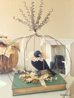 Wire pumpkin cage Awesome idea for a vintage inspired Halloween craft