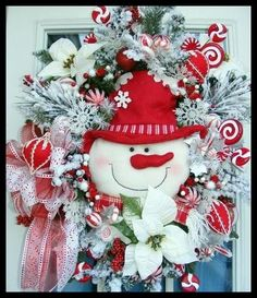 """Snowman Christmas Wreath for front door """"A Jolly Christmas"""" Snowman Wreath IS ON SALE DURING OUR """"CHRISTMAS IN JULY"""" SALE!!! Adorable snowman wreath filled with lavish snow kissed pine, peppermint themed decorations,designer ribbon, and a delightful plush snowman in the center. Decorative Christmas wreath measures approx: 28"""". Free Shipping on ALL Christmas wreaths!!"""