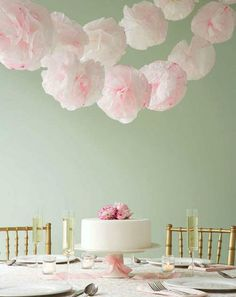 Paper pom pom garlands make an adorable banner for bridal showers. Especially in this blush pink shade.