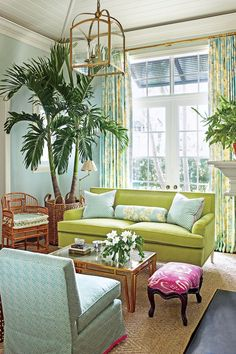 Bright colorful living room with small golden deatails