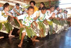 Young men perform a 'Tautonga', the traditional dance