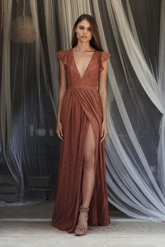 Embroidered stripe maxi dress. Dress has a plunge in the front and the back, and a slit in the front. Dress has a nude lining. Main - 100% Poly Lining - 100% Ra