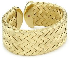 """Roberto Coin """"Fifth Season"""" Yellow Silver Medium Cuff Bracelet Roberto Coin. $1250.00. Created by Italian designer Roberto Coin for the Fifth Season. Classic woven look comes to life with a modern twist for a bold look. Made in Italy. Diameter is 50x60mm"""