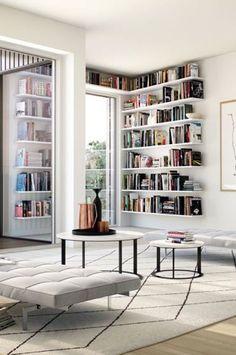 Modern grey living room with white bookshelves