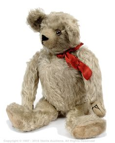 """French 1930s teddy bear, white mohair, clear glass eye with remains of brown painted back, shaven muzzle, black horizontally stitched nose, fully jointed, cotton cloth pads and card lined feet, 17""""/43cm."""