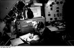 """German Radio Operator using the """"Enigma"""" Device (March 1941)   This photograph shows the cipher machine """"Enigma,"""" which was used by the German army beginning in 1937"""