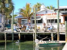 Dock view of The Star Fish Company Restaurant in Cortez , Florida  Insider Tip: Voted best grouper sandwich by Sarasota Magazine Anna Maria Island Beach Life patrons this restaurant by boat!