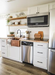 Cheap Home Decor RV kitchen remodel with white cabinets and wood look flooring.Cheap Home Decor RV kitchen remodel with white cabinets and wood look flooring Diy Kitchen, Kitchen Decor, Kitchen Cabinets, White Cabinets, Kitchen Ideas, Soapstone Kitchen, 10x10 Kitchen, Kitchen Inspiration, Rv Cabinets