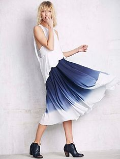 Full Of Love Convertible Skirt   Gauzey and flowy midi skirt featuring an ombre effect.  Adjustable side ties with bell charms.