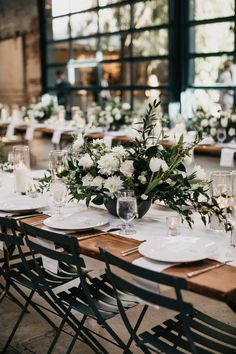 Industrial wedding theme with floral centerpieces, barn wedding, wooden wedding table, black and white wedding color Wedding Table Centerpieces, Wedding Flower Arrangements, Flower Centerpieces, Centerpiece Ideas, Floral Arrangements, Anniversary Centerpieces, Deco Table, Simple Weddings, White Weddings