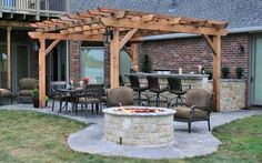 I like the idea of an outdoor kitchen and pergola, as well as the fire pit. Sign me up!